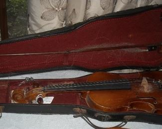 This old violin and original metal case with bow is made in Germany.  Original paper label inside.  Tailpiece has discreet touch of abalone inlay.  Bow is original but needs to be re-haired.