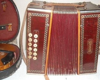 Wonderful old Supertone accordion.  21 keys.  Bellows appear to be in good condition.  Dates to the 30s.