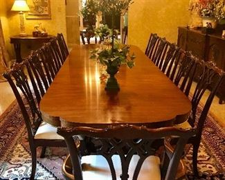 """Table and chairs by Century Furniture. Table is 6ft long, with 3-22"""" leaves included, for max length of 138"""". Also includes the 10 Chippendale side chairs and 2 Chippendale arm chairs also by Century, plus the set of custom pads"""