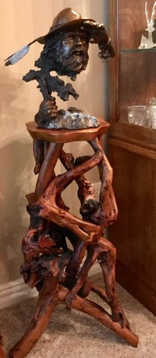 Outstanding Bronze Figure on Tree Root table that are sold separately.