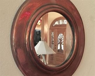 Small Copper round framed mirror.