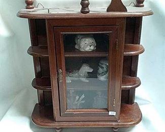 https://connect.invaluable.com/randr/auction-lot/miniature-shelf-cabinet-w-porcelain-figures_8E94AA8934