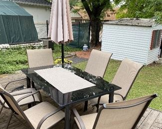 Outdoor table and chairs. Umbrella is attached to deck, but can be taken off by whom ever buys it