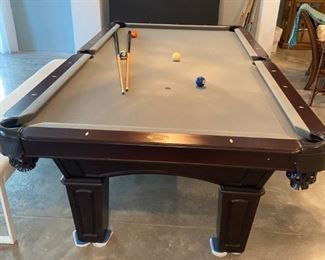 Olhausen Pool Billiards Table, Augusta Model from Olhausen's Signature Series. Cherry wood with light grey felt.  The table is 8' long and has traditional-style pockets.  It is in near mint condition and was handmade in Tennessee.   The original MSRP was approximately $4,500.  Asking $900 Buyer will need to arrange for pool table technician and movers to deliver the table.  Delivery is not included.