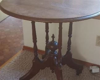 Side table with ball and claw feet on casters