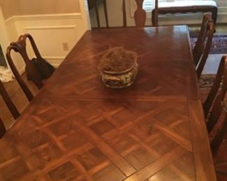 Hickory White parquet dining table with two leaves. Six chairs.
