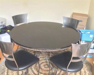 Purchased new for $5,000.  Selling for $1,300 OBO.  Granite top and Leather Chairs.