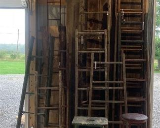 Assorted antique ladders in a variety of lengths and paint hues, vintage Industrial Stool's, Old step Stools, primitive Bench