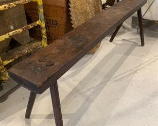 Primitive wood bench, antique boxes, early sawmill blades