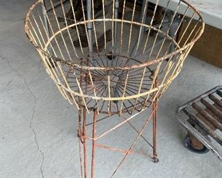 Vintage wire laundry basket with wire base, layers of old chippy paint