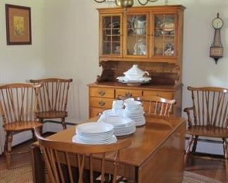 Maple drop leaf dining room table with six chairs, excellent condition.  Oval braided rug.