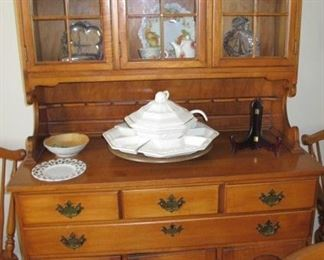 Maple glass front hutch, excellent condition, no scratches.  Misc glassware and silver.