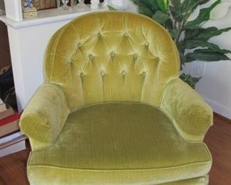 One of two side, gold chairs.