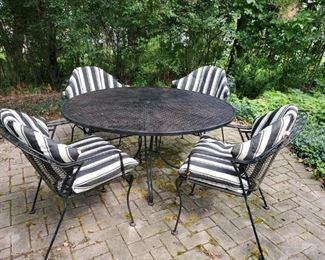 Vintage wrought iron, patio table,  w/ 4 chairs and cushions  Woodard ?  Pretty sure.