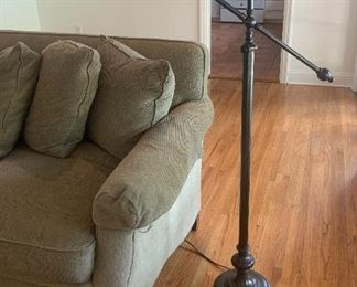 The sofa was sold, but the floor lamp is still available for purchase.