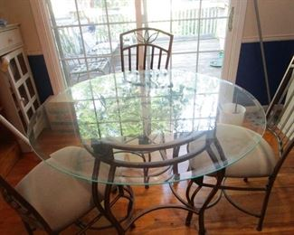 Glass and iron dining table with 4 chairs