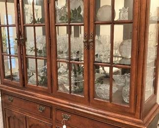 This fine-looking china cabinet provides more than ample display and storage spaces.