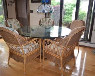 "Rattan Dining Table and 5 Chairs.   Rattan Base 2ft Round and Glass 5ft Round beveled Glass Top and 5 Rattan Chairs 25""W x 38""H Seat 18""D x 18""H (back cushions come off, cushion seat is attached)"