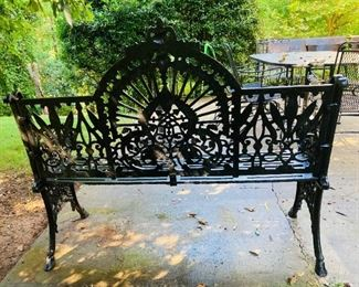 "LATE VICTORIAN CAST IRON GARDEN BENCH IN THE COALBROOKDALE 'PEACOCK' PATTERN. Sculpted arm rests, an arched backrest, and a slatted seat. A unique and comfortable design with excellent detail throughout. Dimensions: 39""H x 46-1/2""L x 22""D"