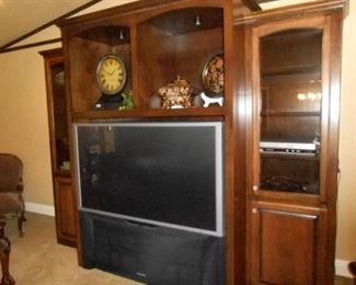Entertainment Center with display cabinets on side.