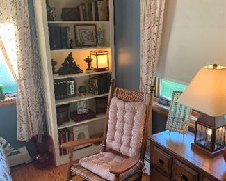 Guest bedroom  Rocking chair, Frank Lloyd Wright stained glass, modern chest of drawers, vintage books, ornate brass bookends, cast iron man of war/knight