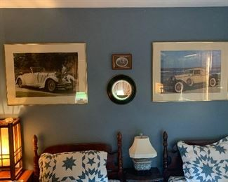Guest bedroom  Pair of twin beds, vintage car prints framed, end tables/nightstand