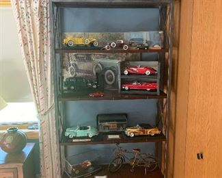 Guest bedroom  Tall metal contemporary bookcase  Model car collection-have boxes for them