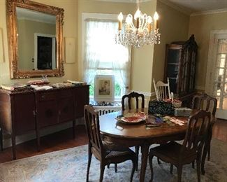 Large mirror Sterling silver plated silverware and serving  Vintage purses box purses  Buffet  Dining room table and chairs  Artwork Cat ribbons  Linens