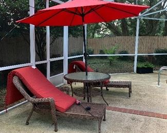 Outdoor table chairs and umbrella