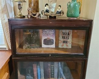 classic glass front bookcase MCM lamps and great book collection
