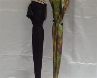 https://connect.invaluable.com/randr/auction-lot/2-retro-umbrellas-1950s-double-layered-umbrella_8064DF4964