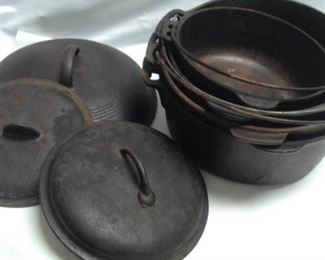https://connect.invaluable.com/randr/auction-lot/cast-iron-dutch-ovens-wagner-ware-with-lids_A174721B1F