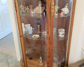 Reproduction Convex Glass Curio Cabinet with all kinds of wonders inside.