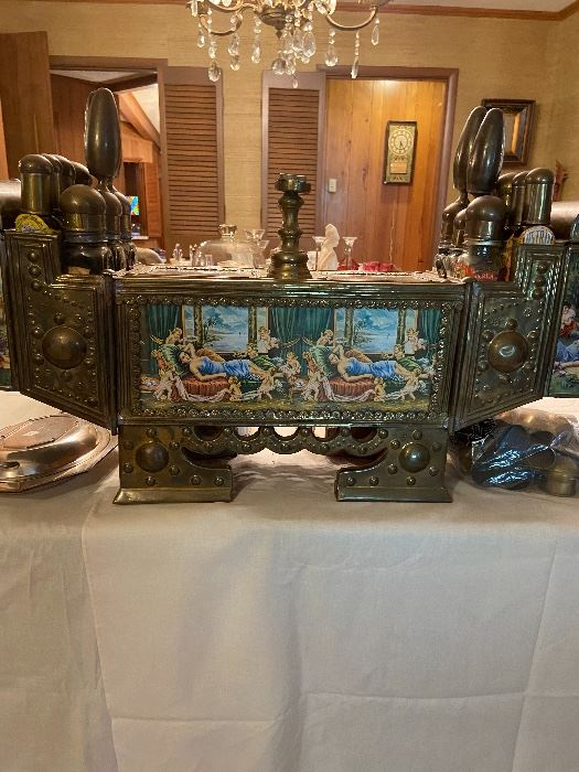 Incredible brass shoe shine box with many glass bottles and supplies.