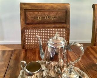 Close up of chairs, also silver coffee set