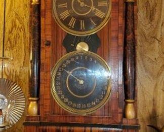 antique calendar pillar clock