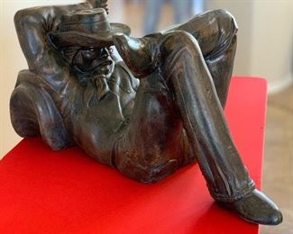Resting Cowboy Statue Metal Faux Bronze Finish	17x17x36in	HxWxD