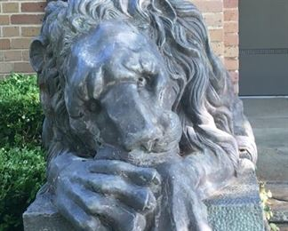 Stately copper lying lion statue