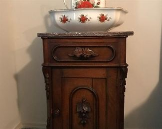 Beautiful Victorian Commode with Chocolate Marble Top and Fruit motif.