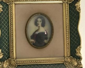 This Pair of Fine Miniature Oval Portraits on Porcelain are framed and signed.