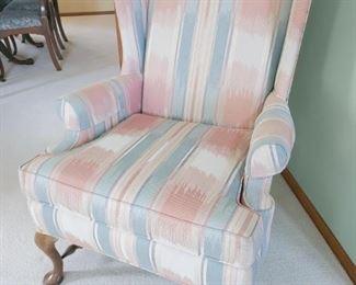 Vintage pastel wingback chair.