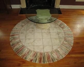 Round area rug and round glass top coffee table