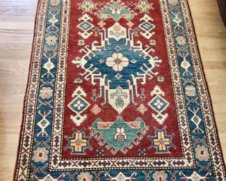 "$450 Persian Heriz rug: 60"" x 41""."