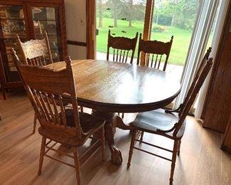 Antique Oak Pedestal table w/6 Oak pressed back antique chairs and 1 leaf