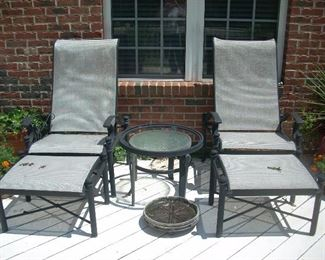 Matching outdoor chairs with foot rests and table