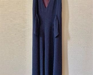 Detail: Back view. Nicole Miller triacetate and polyester navy blue sleeveless v neck dress with tieback.  Size 8.