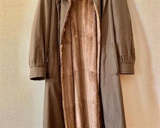$495 Birger Christensen for Bergdorf Goodman, reversible, brown sheared fur lined and trimmed full length raincoat.  Estimated size 1X. Minor repair needed in the sleeve.