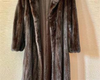 $800 Revillon (Saks Fifth Avenue) three quarter length mink coat.  Estimated size L.