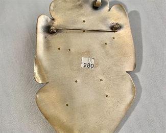 "$280 Detail: Back view. Deb Karash 2001 (Ashville, NC), signed, mixed media pendant/brooch.  3.5""H x 2""W"