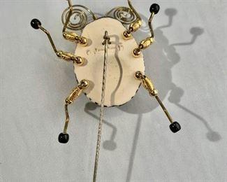 "$80 Detail: Back view. Jewelry-10 beetle stick pin.  2.5""H x 2.5""W"